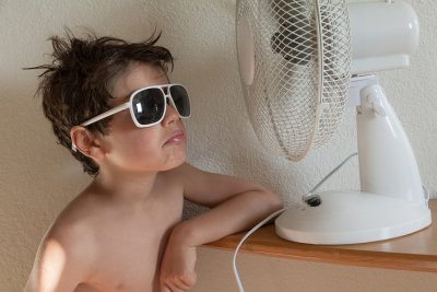 Boy enjoying table fan air